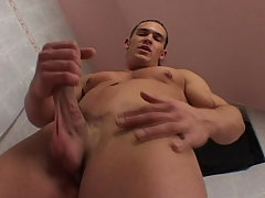 Lang haired guy loves to jerk off his cock in the shower
