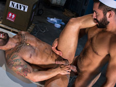 Bruno Bernal is going over some paperwork when Gabriel Taurus sneaks up from behind. Gabriel embarks on passionate kissing, their dark beards rubbing together. Opening his fly, Gabriel pulls out his thick, hefty cock, and Bruno eagerly strokes it. Falling mature gay