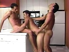 Handsome roommates suck in kitchen