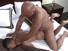 Big dicked Daddy Brian is ecstatic when he spies sexy sub boy Armond Rizzo in the bed.  Armond has no trouble in wrapping his lips around Brian's fat cock and then happily stretches his cheeks so that Brian can pound his tough cock deep inside his ass.  B mature gay
