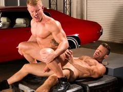 Huge muscled torsos of Johnny V and Landon Conrad compare to the muscle cars in the Auto Erotic Shop. And Johnny's smooth muscled chest contrast mature gay