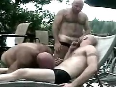 Three mature gays have fun by pool